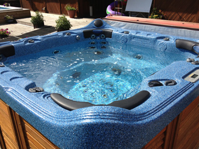 A hot tub sparkling in the sunshine